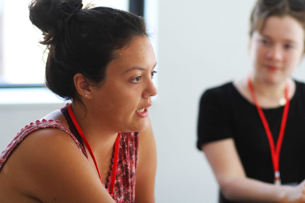 A woman listening to another during the Action Lab